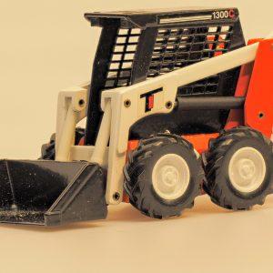 Joal 150 Mini Radlader Scat Trak 1300C